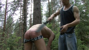 sexy twink is getting his naked behind thrashed by gay lords bdsm spankings until it is fully of red markings.