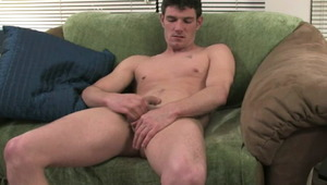 Trashy brunette gay Pearce masturbating his huge meat on the couch