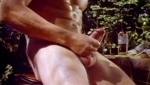 attractive blonde man takes some time to stroke his penis outside