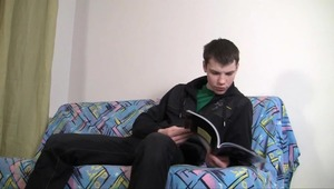 Marvelous twink enjoys jerking off on his comfortable couch.