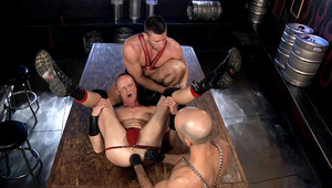 These males take turns working Garet's hole with their fists.
