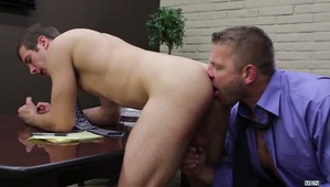 Any time is a good time for a blowjob, even while in the middle of a boardroom meeting.  Cock hungry Spencer Fox crawls under the table and helps himself to a mouthful of Colby Jansen's boner.  When the meeting ends, the real action begins and Colby drill