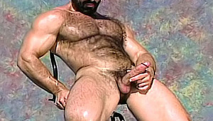 lovely hairy stud gets naked under the sun and masturbates