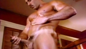 Muscular gay wank his penis off in front of his television
