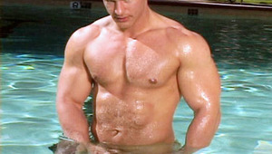 This stunning body builder wanking his meat off in the pool