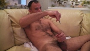 charming young derives great pleasure from wanking his meat with a dipstick inside.