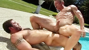 Good looking men banging each other's butt next to the pool
