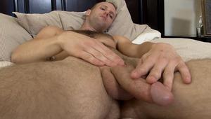 Enjoy Brent as he strokes his hard rock schlong in the bedroom!