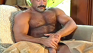 cute cowboy is having lot of fun jerking off his monstrous cock