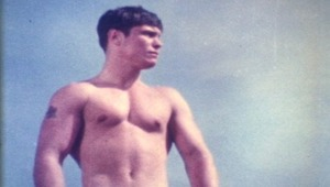 stunning vintage boy wanders the beach in the nude