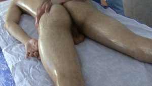 Doctor is stroking twinks meat and balls during sensual oil massage.