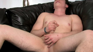 Magnificent brunette gay Bruce jerking his huge meat on the couch