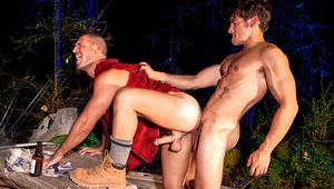 Lit by the campfire, Dale's hard rod assails Parker's hole