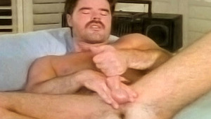 A dude is gives himself pure pleasure with a hot hand job