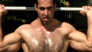 Naked Adam Champ doing his workout session under the sun