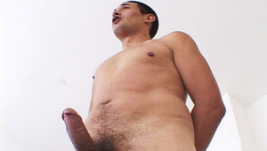 Handsome man with really hot body jerking off his hard rod