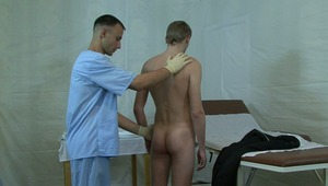 Physician lubricates gay boys booty hole before measuring his temperature.