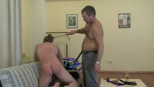 Hot gay takes delight in getting his back spanked by older master until it is welting with redness in kinky bdsm.