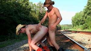 "In episode one of Men.com's ""Going West"" series, cowboy Johnny Rapid was fucked hard by Chris Bines. This time Johnny is on top giving a healthy ass pumping to Robbie Rivers on the train tracks."