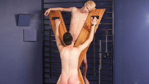 Thomas is a dirty young who likes being chained and bound up on a wooded cross in this boy dungeon. Chase slaps his butt until it turns bright red, but Thomas only begs to get spanked harder and harder. He enjoys being someone's BF toy. Chase uses him as