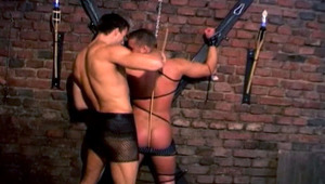 Dominant male spanks and mounts bottom stud in a dungeon !