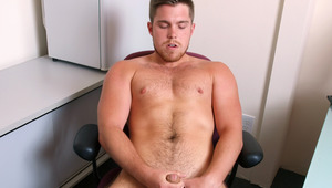 Marko Lebeau jerks his uncut dick while sitting at his desk