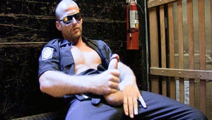 Officer Scott Tanner finds an elevator to stroke his schlong in