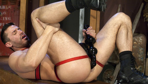 Muscle hunk pleasures his asshole with some monstrous rubber toys