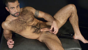 Hairy stud Steve Cruz shoves a huge dildo in his hungry ass