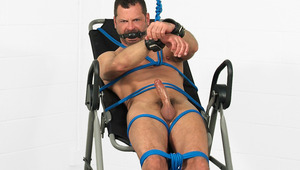 William Martin is tied up & can barely reach his stiff rod