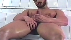 gigantic muscled guy jerks off after a long & hard training