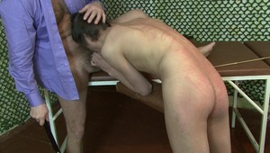 After receiving rough flogging from master, young gay man takes delight in swallowing masters dong in bdsm sex.