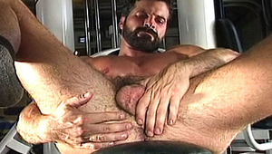 lovely gay is flexing his strong muscles & gets a giant erection