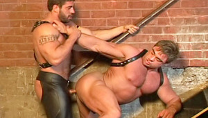 Horny muscular guys in leather licking each other's penis
