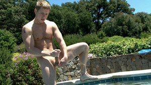 Tommy is taking a dip in the pool before stroking is rod!