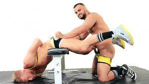 Christopher is bent over a bench and rimmed fiercely by Tony