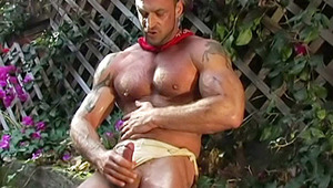 Handsome dude doiong his garden wants to masturbate badly!