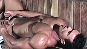Hot pretty bodybuilder playing with his cock in a sona & cums