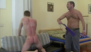 Watching sweet boys body turning red from his savage spanking pleases horny gay master tremendously.