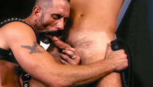 Harley has Scott tied to a St Andrew's Cross for flogging