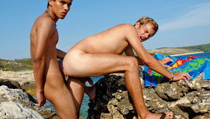 two Frat Boys sharing some skin and penis on the white sand.