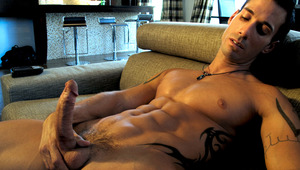 Alexy kicks back, fucks his couch and rubs his tight hole!