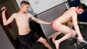 Michael Lee spanks Blake Carnage on a gym workout bench. Starring: Blake Carnage, Michael Lee