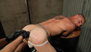 Hot man stretches his booty, getting it ready for 2 enormous fists!