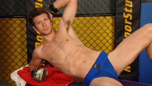He's leaning against the cage in a full on stroker's workout