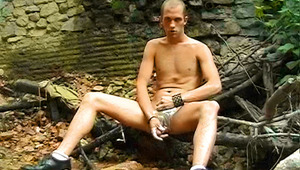 cute dude enjoying shaving and stroking his rod in nature