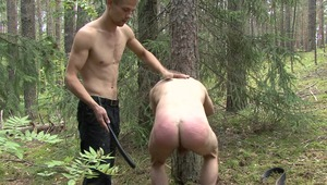 Horny lord is showing no mercy to cute twink gay guy as he paddles males lovely bottoms viciously in bdsm sex tape.