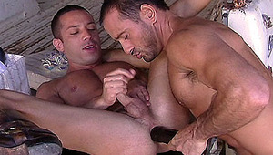 two enormous studs getting their asses banged with large ebony toys!