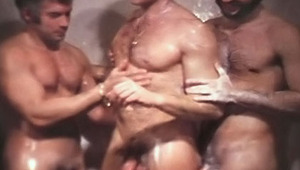 three dudes having lots of fun in the shower cleaning their cocks