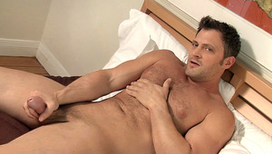 Very handsome guy jerking off his cock while watching porn